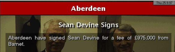 Sean Devine signs